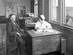 "Image: ""Nurse with patient in City Hospital Tuberculosis Division, 1927"" by Seattle Municipal Archives. License: CC BY 2.0"