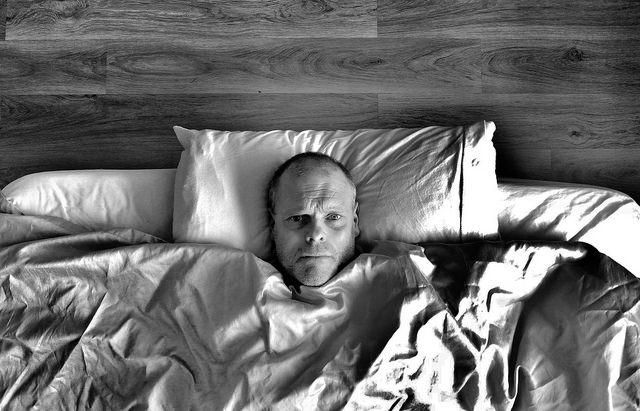Man in bed awake